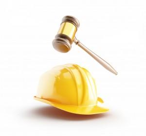 construction helmet, wood gavel, law
